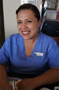 Long-time member of our staff, Carmen - Receptionist Center-Sinai Animal Hospital, delights pets & pet parents. She's knowledgeable, friendly, loves pets!