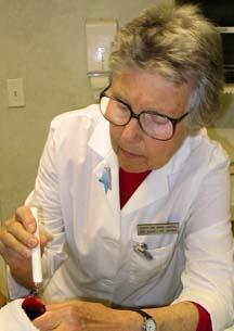 Center-Sinai Avian Specialist Emeritus Dr. Anelise Spira Treating Bird